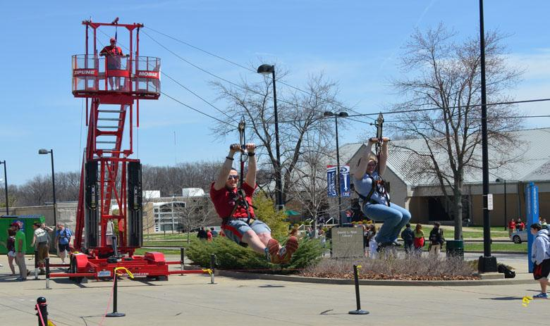 Students glide through the air on a zip line during USI's SpringFest festivities in 2014.
