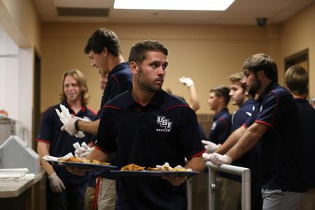 'Humble' helping hand: men's soccer team serves meals at Rescue Mission